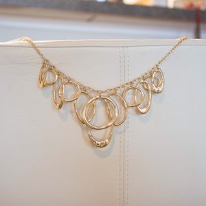 Gold hoop necklace unknown material